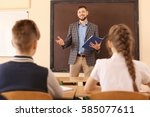 pupils listening teacher in...   Shutterstock . vector #585077611