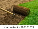 gardener applying turf rolls in ... | Shutterstock . vector #585101599