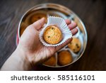 a shortbread cookies in one's... | Shutterstock . vector #585116101