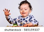 one year old kid eating a slice ... | Shutterstock . vector #585159337