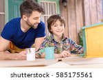 happy father looking at son... | Shutterstock . vector #585175561