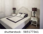 bright bedroom in white color... | Shutterstock . vector #585177361