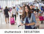 asian woman at international... | Shutterstock . vector #585187084