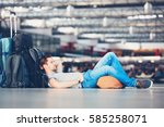 traveler waiting at the airport ... | Shutterstock . vector #585258071