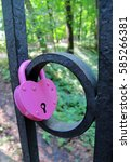 Small photo of Love padlock affixed to a fence in park