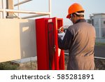 safety officials checking a... | Shutterstock . vector #585281891