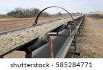 industrial belt conveyor.... | Shutterstock . vector #585284771