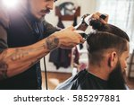close up shot of man getting... | Shutterstock . vector #585297881
