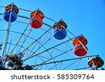 Small photo of Part of blue and red ferris wheel. Sunny day in Belgorod, Russia