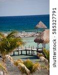 bungalows on a beautiful beach | Shutterstock . vector #585327791