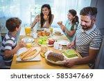 happy family having breakfast... | Shutterstock . vector #585347669