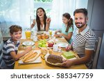 happy family having breakfast... | Shutterstock . vector #585347759