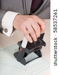 Male hand with rubber stamp - stock photo