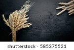 rye  wheat wooden on black... | Shutterstock . vector #585375521