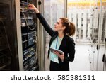 technician holding digital... | Shutterstock . vector #585381311