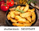 fried potatoes in a rural style ... | Shutterstock . vector #585395699