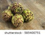 artichokes on wooden background   Shutterstock . vector #585400751