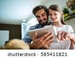 father and daughter using... | Shutterstock . vector #585411821