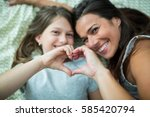 mother and daughter making... | Shutterstock . vector #585420794