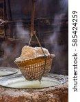 traditional salt making  salt... | Shutterstock . vector #585424259