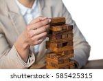 business man placing wooden... | Shutterstock . vector #585425315