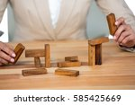 Business Man Placing Wooden...