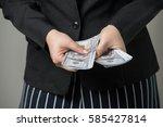 business woman holding money on ... | Shutterstock . vector #585427814