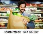 handsome man shopping in a... | Shutterstock . vector #585433409