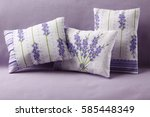 three lavender cushions | Shutterstock . vector #585448349