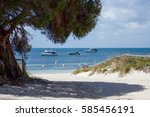 boats in the indian ocean at... | Shutterstock . vector #585456191