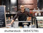 Small photo of small business, people and service concept - happy seller man or barman at counter with cashbox in vegan cafe or coffee shop