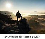 man silhouette stay on sharp... | Shutterstock . vector #585514214