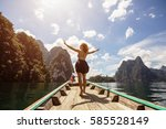 happy female traveling by boat... | Shutterstock . vector #585528149