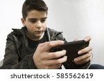 child with mobile phone | Shutterstock . vector #585562619