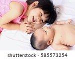 little sister hugging her... | Shutterstock . vector #585573254