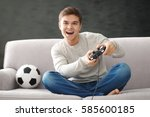 teenager playing videogame at... | Shutterstock . vector #585600185
