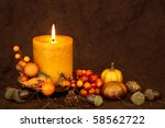 Autumn Candle On A Brown...