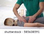 woman having chiropractic back... | Shutterstock . vector #585638591