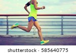 Small photo of healthy lifestyle young fitness woman running at seaside