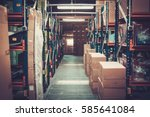 crates and boxes on a shelves... | Shutterstock . vector #585641084
