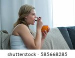 woman having breakfast in... | Shutterstock . vector #585668285