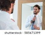 man getting dressed in bedroom... | Shutterstock . vector #585671399