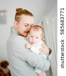 baby in fathers hands | Shutterstock . vector #585683771