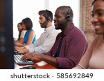 Small photo of Staff Working In Busy Customer Service Department Shot