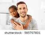 happy father with cute african... | Shutterstock . vector #585707831