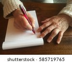 woman with arthritis trying to... | Shutterstock . vector #585719765