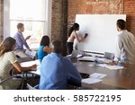 businesswoman at whiteboard in... | Shutterstock . vector #585722195