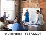 businesswoman at whiteboard in... | Shutterstock . vector #585722207