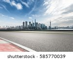 clean asphalt road with city... | Shutterstock . vector #585770039
