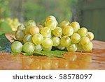grape on green sheet with... | Shutterstock . vector #58578097